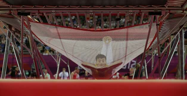 China's Lu Chunlong performs during the men's trampoline finals at the 2012 Summer Olympics, Friday, Aug. 3, 2012, in London.  (Gregory Bull / Associated Press)
