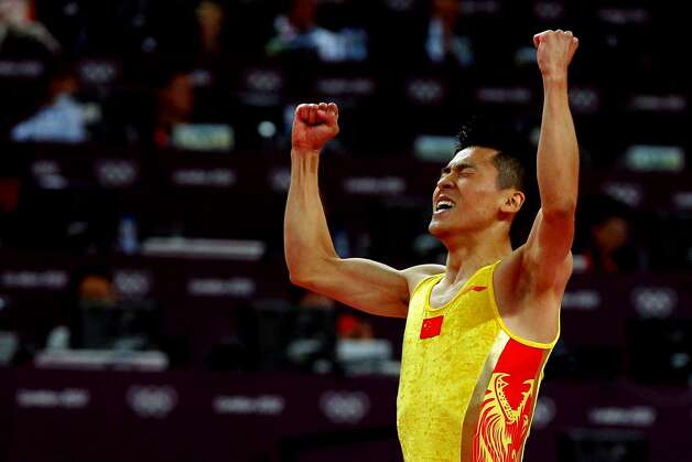Dong Dong of China reacts after competing on the Men's Trampoline during Day 7 of the London 2012 Olympic Games at North Greenwich Arena on August 3, 2012 in London, England.  (Cameron Spencer / Getty Images)