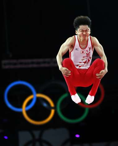 Japan's Masaki Ito grimaces as he competes in the men's trampoline final of the artistic gymnastics event of the London 2012 Olympic Games in London on August 3, 2012. China's Dong Dong won the gold, Russia's Dmitry Ushakov the silver and China's Lu Chunlong bronze.  (THOMAS COEX / AFP/Getty Images)