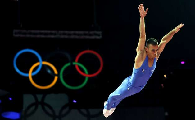 Italy's Flavio Cannone competes in the men's trampoline final of the artistic gymnastics event of the London 2012 Olympic Games in London on August 3, 2012. China's Dong Dong won the gold, Russia's Dmitry Ushakov the silver and China's Lu Chunlong bronze. (THOMAS COEX / AFP/Getty Images)