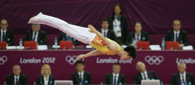 Bronze medallist China's Lu Chunlong  performs on the trampoline at the 2012 Summer Olympics, Friday, Aug. 3, 2012, in London.  (Julie Jacobson / Associated Press)