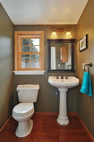 Powder room of 11332 34th Ave. N.E. The 1,990-square-foot house, built in 1932, has four bedrooms, 2.5 bathrooms, a basement with a rec room and French doors leading to a deck on a 7,740-square-foot lot, with a shed/workshop. It's listed for $439,000. Photo: Courtesy Jill Cunningham/Windermere Real Estate