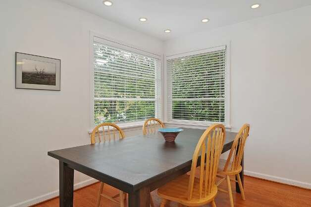 Dining room of 11332 34th Ave. N.E. The 1,990-square-foot house, built in 1932, has four bedrooms, 2.5 bathrooms, a basement with a rec room and French doors leading to a deck on a 7,740-square-foot lot, with a shed/workshop. It's listed for $439,000. Photo: Courtesy Jill Cunningham/Windermere Real Estate