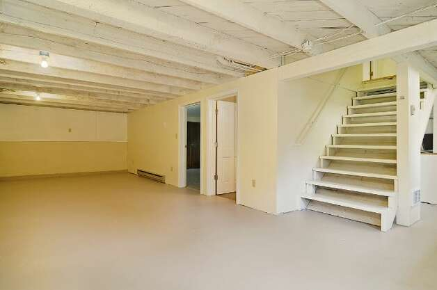 Basement rec room of 11332 34th Ave. N.E. The 1,990-square-foot house, built in 1932, has four bedrooms, 2.5 bathrooms and French doors leading to a deck on a 7,740-square-foot lot, with a shed/workshop. It's listed for $439,000. Photo: Courtesy Jill Cunningham/Windermere Real Estate