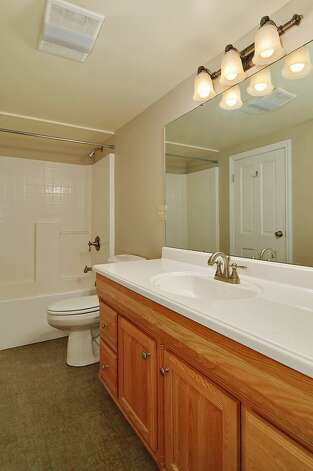Basement bathroom of 11332 34th Ave. N.E. The 1,990-square-foot house, built in 1932, has four bedrooms, 2.5 bathrooms and French doors leading to a deck on a 7,740-square-foot lot, with a shed/workshop. It's listed for $439,000. Photo: Courtesy Jill Cunningham/Windermere Real Estate