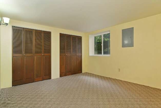 Basement bedroom of 11332 34th Ave. N.E. The 1,990-square-foot house, built in 1932, has four bedrooms, 2.5 bathrooms and French doors leading to a deck on a 7,740-square-foot lot, with a shed/workshop. It's listed for $439,000. Photo: Courtesy Jill Cunningham/Windermere Real Estate