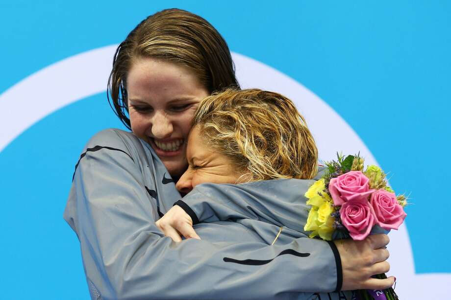Gold medalist Missy Franklin of the United States and bronze medalist Elizabeth Beisel of the United States embrace on the podium during the medal ceremony for the Women's 200m Backstroke Final on Day 7 of the London 2012 Olympic Games at the Aquatics Centre on August 3, 2012 in London, England.   (Al Bello / Getty Images)