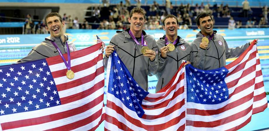 From left, United States' Michael Phelps, United States' Conor Dwyer, United States' Ricky Berens and United States' Ryan Lochte pose with their gold medals for the men's 4x200-meter freestyle relay swimming final at the Aquatics Centre in the Olympic Park during the 2012 Summer Olympics in London, Tuesday, July 31, 2012. (Mark J. Terrill / Associated Press)