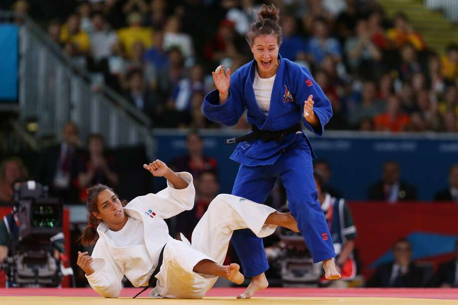 Marti Malloy of the United States celebrates winning the bronze medal A against Giulia Quintavalle of Italy in the Women's -57 kg Judo on Day 3 of the London 2012 Olympic Games at ExCeL on July 30, 2012 in London, England.   (Julian Finney / Getty Images)