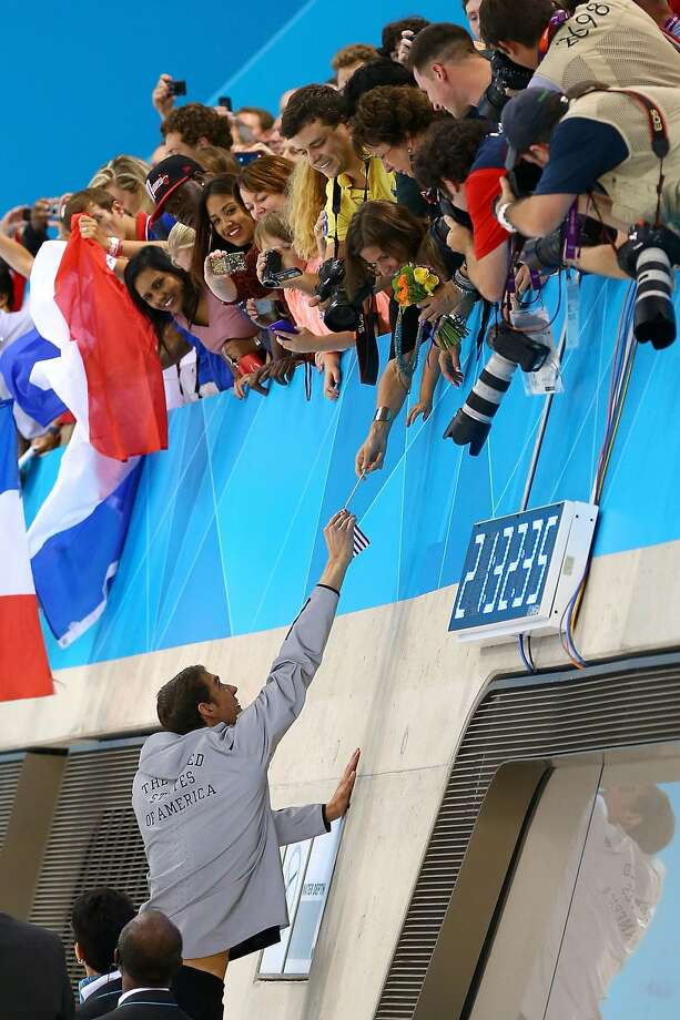 Michael Phelps celebrates with his sister Whitney following the medal ceremony for the Men's 4 x 200m Freestyle Relay final on Day 4 of the London 2012 Olympic Games at the Aquatics Centre on July 31, 2012 in London, England.  (Al Bello / Getty Images)