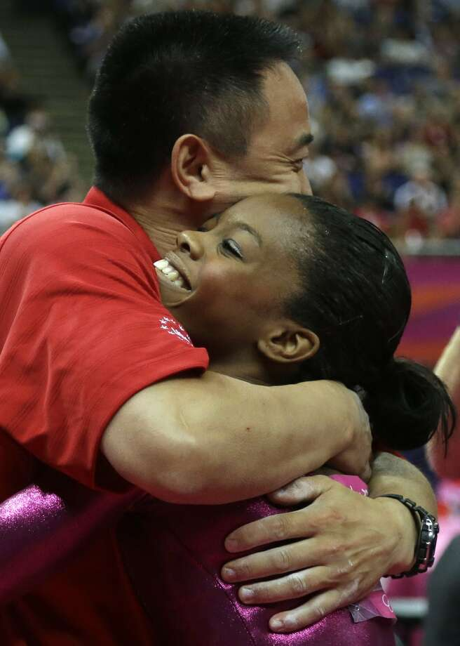 U.S. gymnast Gabrielle Douglas is hugged by coach Liang Chow after her final and deciding performance on the floor during the artistic gymnastics women's individual all-around competition at the 2012 Summer Olympics, Thursday, Aug. 2, 2012, in London.  (Julie Jacobson / Associated Press)