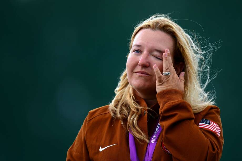 Kimberly Rhode of the United States wipes her eye while standing on the podium after winning the gold medal in the Women's Skeet Shooting on Day 2 on Day 2 of the London 2012 Olympic Games at The Royal Artillery Barracks on July 29, 2012 in London, England.  (Lars Baron / Getty Images)