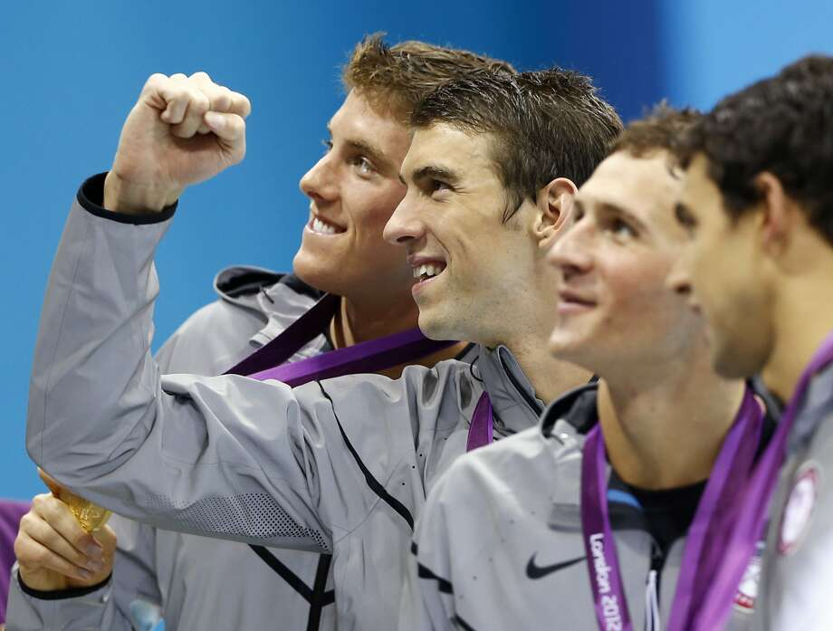 United States' Conor Dwyer, left, Michael Phelps, center, Ryan Lochte, second right, and Ricky Berens, right, pose with their gold medals after their win in the men's 4 x 200-meter freestyle relay at the Aquatics Centre in the Olympic Park during the 2012 Summer Olympics in London, Tuesday, July 31, 2012.  (Daniel Ochoa De Olza / Associated Press)