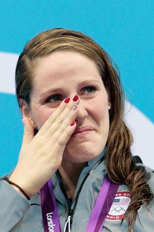 Missy Franklin of the United States wipes a tear from her face as she reacts during the medal ceremony for the Women's 100m Backstroke on Day 3 of the London 2012 Olympic Games at the Aquatics Centre on July 30, 2012 in London, England.  (Adam Pretty / Getty Images)