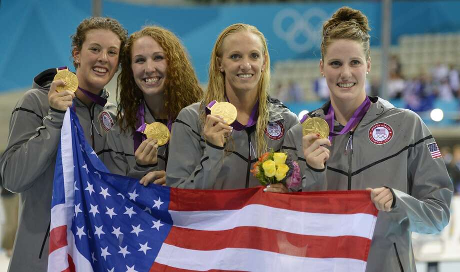 From right, United States' Missy Franklin, Dana Vollmer, Shannon Vreeland and Allison Schmitt pose with their gold medals for the women's 4x200-meter freestyle relay swimming final at the Aquatics Centre in the Olympic Park during the 2012 Summer Olympics in London, Wednesday, Aug. 1, 2012. (Mark J. Terrill / Associated Press)