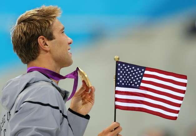 Matt Grevers of the United States celebrates with his gold medal during the medal ceremony for the Men's 100m Backstroke on Day 3 of the London 2012 Olympic Games at the Aquatics Centre on July 30, 2012 in London, England.  (Clive Rose / Getty Images)