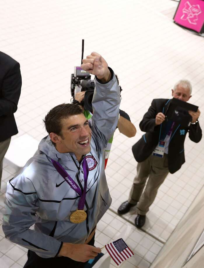 Michael Phelps of the United States celebrates with his family following the medal ceremony for the Men's 4 x 200m Freestyle Relay final on Day 4 of the London 2012 Olympic Games at the Aquatics Centre on July 31, 2012 in London, England. (Ezra Shaw / Getty Images)