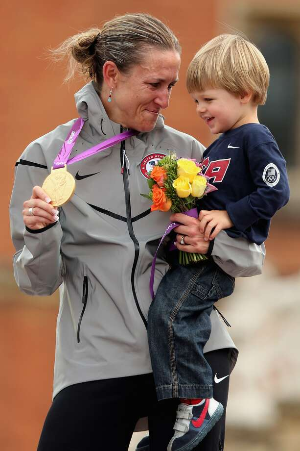 Gold medalist Kristin Armstrong of the United States celebrates with her son during the medal ceremony after the Women's Individual Time Trial Road Cycling on day 5 of the London 2012 Olympic Games on August 1, 2012 in London, England.  (Bryn Lennon / Getty Images)