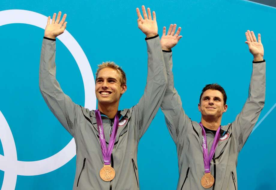 Bronze medalists Kristian Ipsen and Troy Dumais of the United States pose on the podium during the medal ceremony for the Men's Synchronised 3m Springboard final on Day 5 of the London 2012 Olympic Games at the Aquatics Centre on August 1, 2012 in London, England. (Adam Pretty / Getty Images)