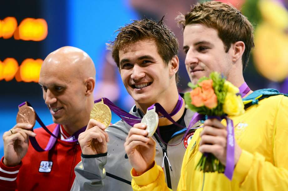 Bronze medalist Brent Hayden of Canada, gold medalist Nathan Adrian of the United States and silver medalist James Magnussen of Australia pose with their medals  during the medal cermony for the Men's 100m Freestyle on Day 5 of the London 2012 Olympic Games at the Aquatics Centre on August 1, 2012 in London, England.  (Photo by Mike Hewitt/Getty Images) (Mike Hewitt / Getty Images)