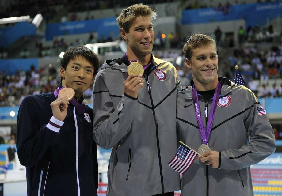 From left, Japan's Ryosuke Irie, United States' Matthew Grevers and United States' Nick Thoman pose with their medals for the men's 100-meter backstroke swimming final at the Aquatics Centre in the Olympic Park during the 2012 Summer Olympics in London, Monday, July 30, 2012. Grevers won gold, Thoman silver and Irie bronze.  (Mark J. Terrill / Associated Press)