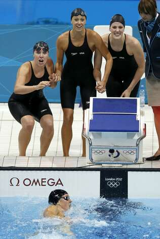 United States' Allison Schmitt, swims to the finish as teammates Shannon Vreeland, top left, Dana Vollmer, top center, and Missy Franklin, top right, cheer her on as the team wins a gold medal in the women's 4x200-meter freestyle relay swimming final at the Aquatics Centre in the Olympic Park during the 2012 Summer Olympics in London, Wednesday, Aug. 1, 2012.  (Daniel Ochoa De Olza / Associated Press)