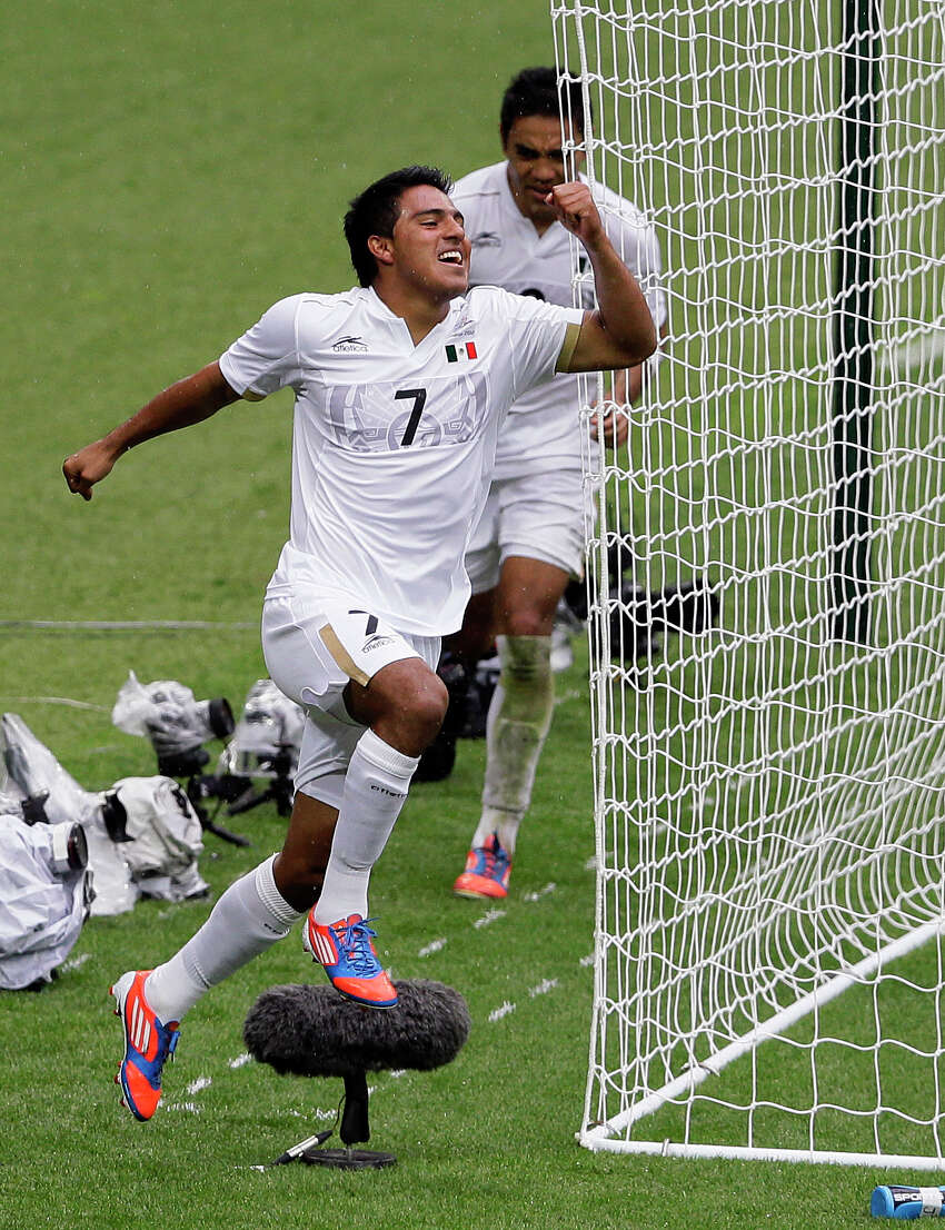Mexico's Javier Cortes celebrates after scoring against Japan in during their semifinal soccer match at Wembley Stadium at the 2012 Summer Olympics, in London, Tuesday, Aug. 7, 2012. (AP Photo/Kirsty Wigglesworth)