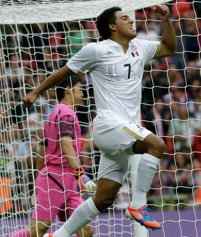 Mexico's Javier Cortes celebrates after scoring during the men's soccer semifinal match between Japan and Mexico at Wembley Stadium, at the 2012 Summer Olympics, Tuesday, Aug. 7, 2012, in London. (AP Photo/Luca Bruno) Photo: Luca Bruno, Associated Press / AP