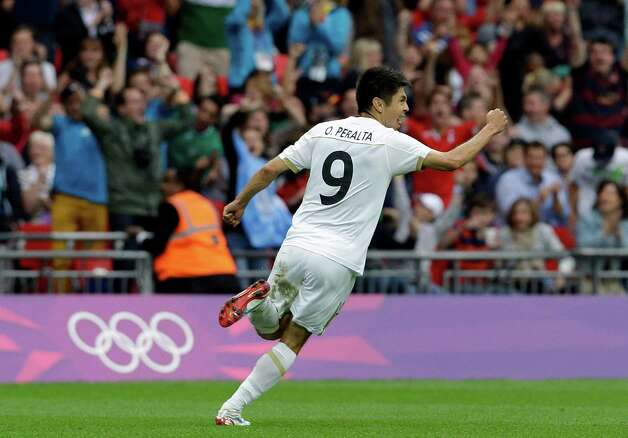 Mexico's Oribe Peralta celebrates after scoring during the men's soccer semifinal match between Japan and Mexico at the Wembley stadium, at the 2012 London Summer Olympics, Tuesday, Aug. 7, 2012, in London. (AP Photo/Luca Bruno) Photo: Luca Bruno, Associated Press / AP