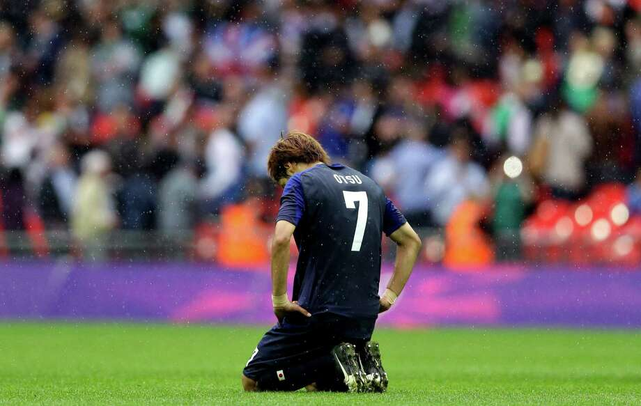 Japan's Yuki Otsu reacts at the end of the men's soccer semifinal match against Mexico at Wembley Stadium at the 2012 Summer Olympics, Tuesday, Aug. 7, 2012, in London. Mexico won 3-1. (AP Photo/Victor R. Caivano) Photo: Victor R. Caivano, Associated Press / AP