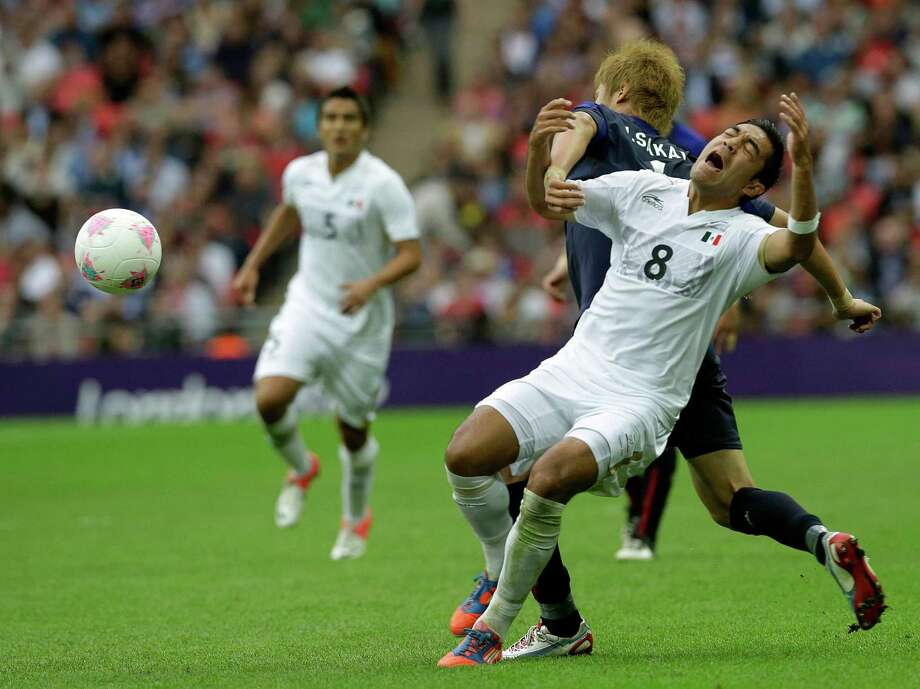 Mexico's Marco Fabian, right, vies for the ball with Japan's Hiroki Sakai during the men's soccer semifinal match between Japan and Mexico at Wembley Stadium, at the 2012 Summer Olympics, Tuesday, Aug. 7, 2012, in London. (AP Photo/Luca Bruno) Photo: Luca Bruno, Associated Press / AP