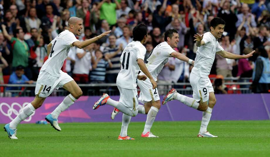 Mexico's Oribe Peralta (9) celebrates his goal with teammates Jorge Enriquez (14), Javier Aquino (11) and Israel Jimenez, second right, during their men's soccer semifinal match against Japan at Wembley Stadium during the 2012 Summer Olympics, Tuesday, Aug. 7, 2012, in London. (AP Photo/Luca Bruno) Photo: Luca Bruno, Associated Press / AP