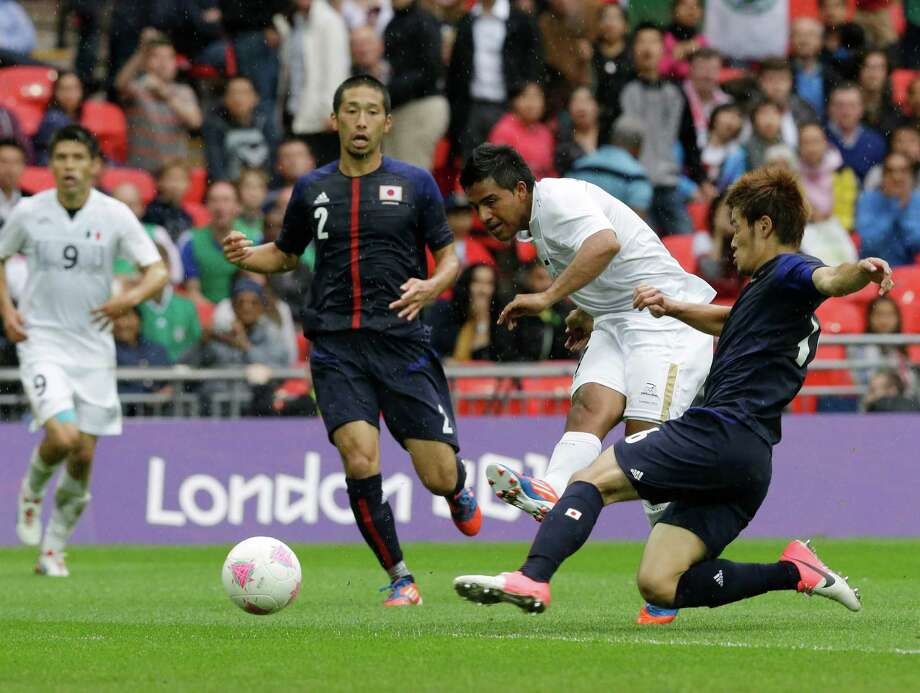 Mexico's Javier Cortes scores during the men's soccer semifinal match between Japan and Mexico at Wembley Stadium, at the 2012 Summer Olympics, Tuesday, Aug. 7, 2012, in London. (AP Photo/Luca Bruno) Photo: Luca Bruno, Associated Press / AP