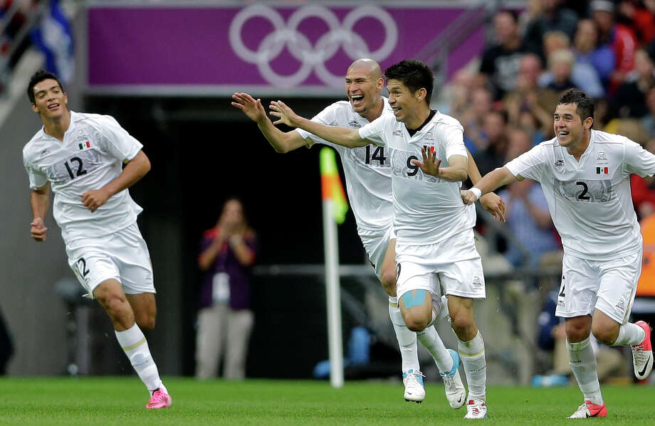 Mexico's Oribe Peralta (9) celebrates his goal with teammates Jorge Enriquez, (14), Raul Jimenez (12) and Israel Jimenez (2) during their men's soccer semifinal match against Japan at Wembley Stadium at the 2012 Summer Olympics, Tuesday, Aug. 7, 2012, in London. (AP Photo/Victor R. Caivano) Photo: Victor R. Caivano, Associated Press / AP