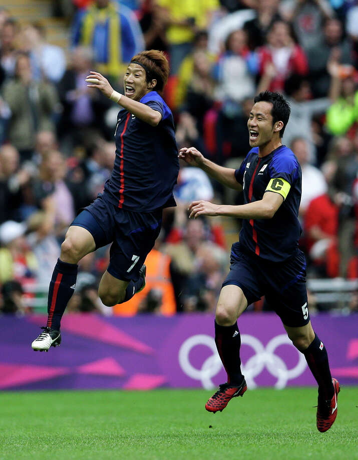 Japan's Yuki Otsu, left, celebrates his goal with teammate Maya Yoshida, right, during their men's soccer semifinal match against Mexico at Wembley Stadium at the 2012 Summer Olympics, Tuesday, Aug. 7, 2012, in London. (AP Photo/Victor R. Caivano) Photo: Victor R. Caivano, Associated Press / AP
