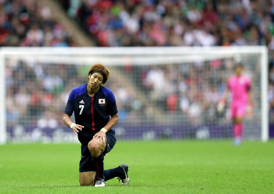 Japan's Yuki Otsu reacts during their men's soccer semifinal match against Mexico at Wembley Stadium at the 2012 Summer Olympics, Tuesday, Aug. 7, 2012, in London. Mexico won 3-1. (AP Photo/Victor R. Caivano) Photo: Victor R. Caivano, Associated Press / AP