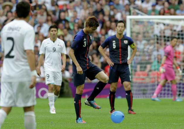 Japan's Takahiro Ohgihara plays with a balloon during the men's soccer semifinal match between Japan and Mexico at Wembley Stadium, at the 2012 London Summer Olympics, Tuesday, Aug. 7, 2012. (AP Photo/Luca Bruno) Photo: Luca Bruno, Associated Press / AP