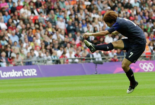 Japan's Yuki Otsu scores during the men's soccer semifinal match between Japan and Mexico at Wembley Stadium, at the 2012 Summer Olympics, Tuesday, Aug. 7, 2012, in London. (AP Photo/Luca Bruno) Photo: Luca Bruno, Associated Press / AP