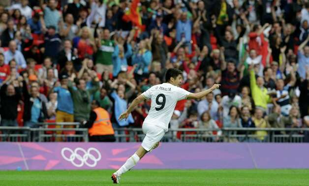Mexico's Oribe Peralta celebrates after scoring during the men's soccer semifinal match between Japan and Mexico at Wembley Stadium, at the 2012 Summer Olympics, Tuesday, Aug. 7, 2012, in London. (AP Photo/Luca Bruno) Photo: Luca Bruno, Associated Press / AP