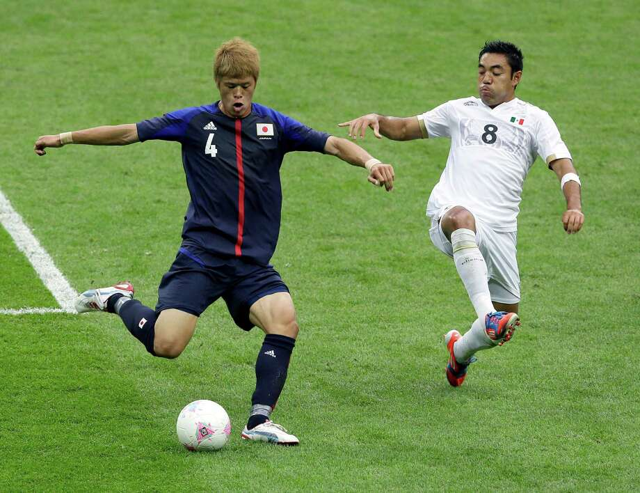 Mexico's Marco Fabian, right, and Japan's Hiroki Sakai vie for the ball during their semifinal soccer match at Wembley Stadium at the 2012 Summer Olympics, in London, Tuesday, Aug. 7, 2012. (AP Photo/Kirsty Wigglesworth) Photo: Kirsty Wigglesworth, Associated Press / AP