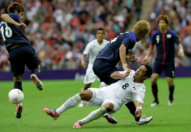 Mexico's Marco Fabian, right, vies for the ball with Japan's Hiroki Sakai and Hotaru Yamaguchi during the men's soccer semifinal match between Japan and Mexico at Wembley Stadium, at the 2012 Summer Olympics, Tuesday, Aug. 7, 2012, in London. (AP Photo/Luca Bruno) Photo: Luca Bruno, Associated Press / AP