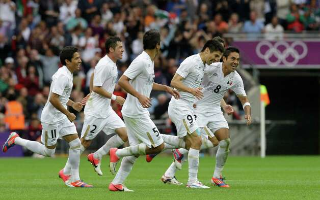 Mexico's Oribe Peralta, (9) celebrates after scoring with teammates Marco Fabian, right, and from left Javier Aquino, Israel Jimenez, and Darvin Chavez during the men's soccer semifinal match between Japan and Mexico at Wembley Stadium, at the 2012 London Summer Olympics, Tuesday, Aug. 7, 2012, in London. (AP Photo/Luca Bruno) Photo: Luca Bruno, Associated Press / AP