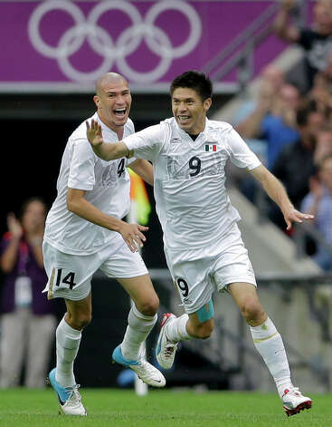 Mexico's Oribe Peralta, right, celebrates his goal with teammate Mexico's Jorge Enriquez, left, during their men's soccer semifinal match against Japan at Wembley Stadium at the 2012 Summer Olympics, Tuesday, Aug. 7, 2012, in London. (AP Photo/Victor R. Caivano) Photo: Victor R. Caivano, Associated Press / AP