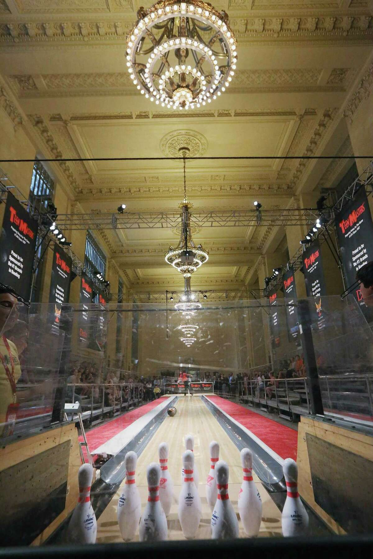 NEW YORK, NY - AUGUST 07: Ashley Dunn bowls during the 2012 Teen Masters Bowling Championship in Grand Central Terminal on August 7, 2012 in New York City. The championship is the second time in history that Grand Central's Vanderbilt Hall has hosted a bowling alley.