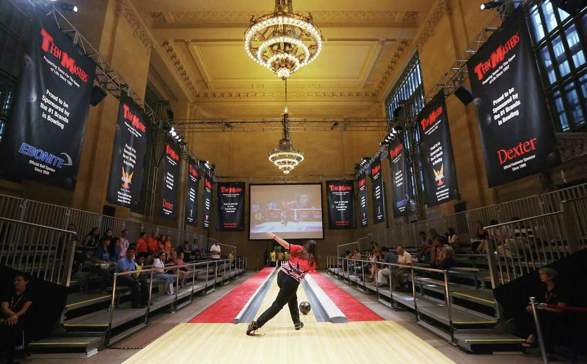 NEW YORK, NY - AUGUST 07: Ashley Dunn bowls in the 2012 Teen Masters Bowling Championship in Grand Central Terminal on August 7, 2012 in New York City. The championship is the second time in history that Grand Central's Vanderbilt Hall has hosted a bowling alley.