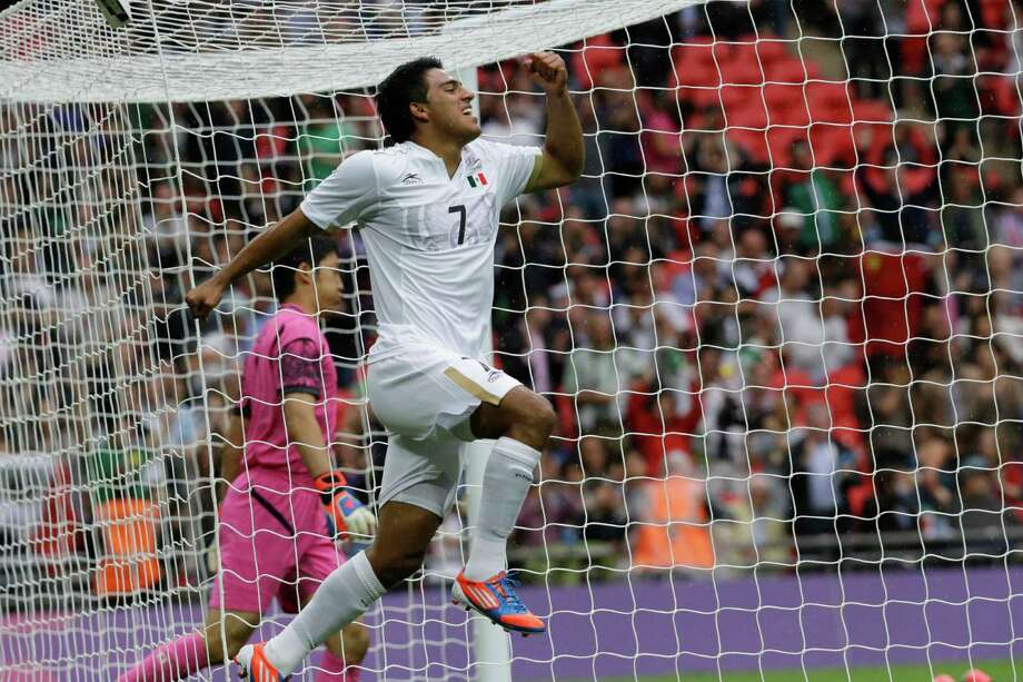 Mexico's Javier Cortes, celebrates after scoring during the men's soccer semifinal match between Japan and Mexico at Wembley Stadium, at the 2012 London Summer Olympics, Tuesday, Aug. 7, 2012, in London. (AP Photo/Luca Bruno) Photo: Luca Bruno, Associated Press / AP
