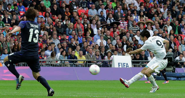 Mexico's Oribe Peralta scores during the men's soccer semifinal match between Japan and Mexico at the Wembley stadium, at the 2012 London Summer Olympics, Tuesday, Aug. 7, 2012, in London. (AP Photo/Luca Bruno) Photo: Luca Bruno, Associated Press / AP