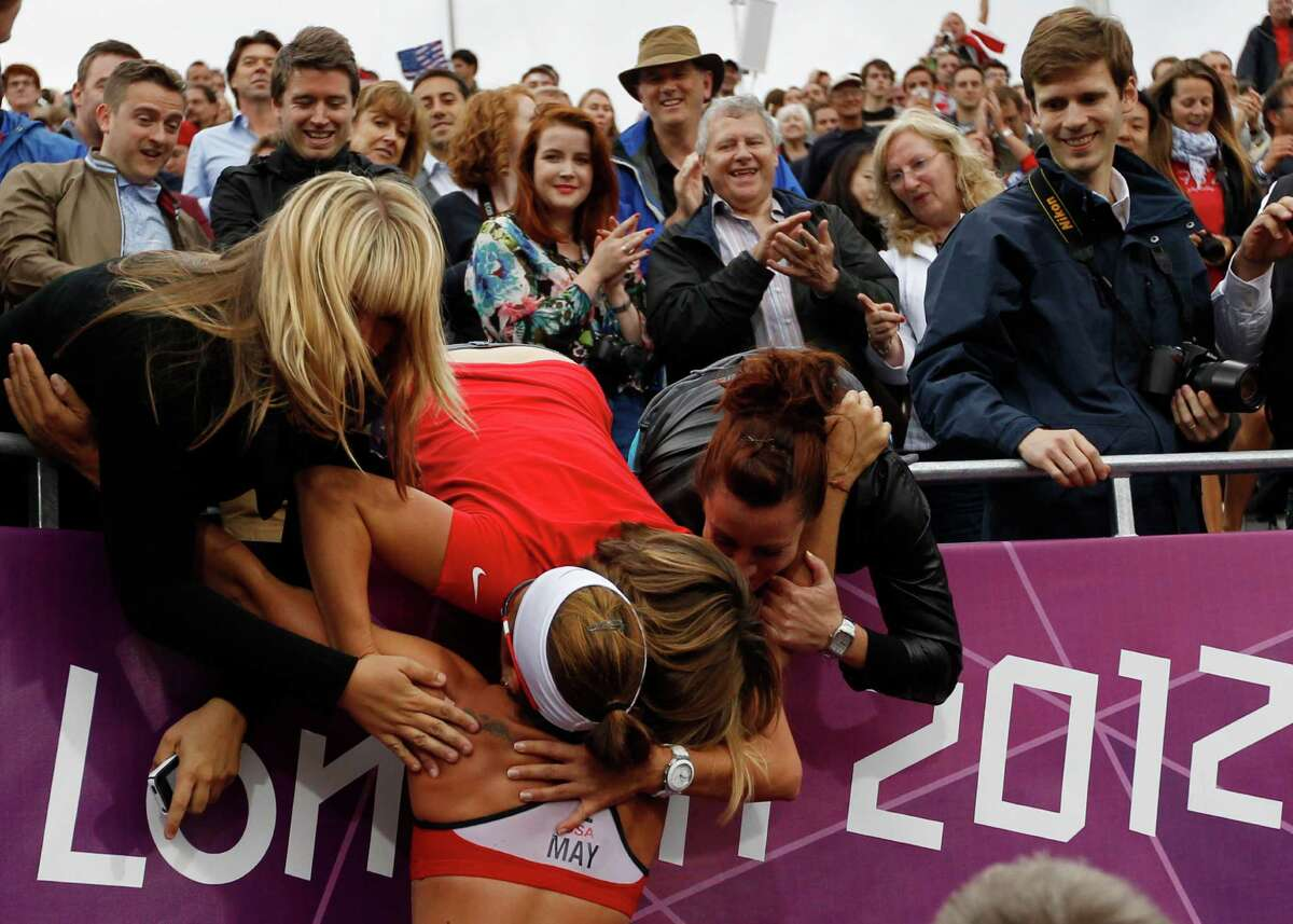 US Misty May-Treanor celebrates with her frriends and fans after defeating China in the semifinal women's beach volleyball match at the 2012 Summer Olympics, Tuesday, Aug. 7, 2012, in London.