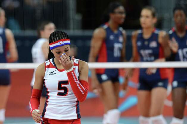 Dominican Republic's Brenda Castillo reacts during the Women's quarterfinal volleyball match between the US and Dominican Republic in the 2012 London Olympic Games in London on August 7, 2012. AFP PHOTO/KIRILL KUDRYAVTSEVKIRILL KUDRYAVTSEV/AFP/GettyImages Photo: KIRILL KUDRYAVTSEV, AFP/Getty Images / AFP