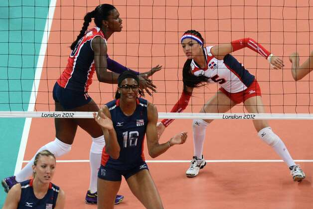 US player Foluke Akinradewo (C) reacts during the Women's quarterfinal volleyball match between the US and the Dominican Republic in the 2012 London Olympic Games in London on August 7, 2012. AFP PHOTO/KIRILL KUDRYAVTSEVKIRILL KUDRYAVTSEV/AFP/GettyImages Photo: KIRILL KUDRYAVTSEV, AFP/Getty Images / AFP